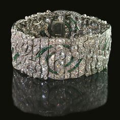 Beautiful and rare diamond and emerald open-work strap bracelet of repeating floral and foliate-scroll design Auger Frères, Paris circa 1930 --- COME TO MAMA!!!