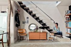 Wardrobe under staircase. Apartment in Paris by l'Atelier d'Archi.