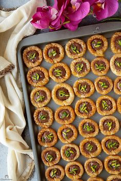 Delicately crisp phyllo rings with a creamy chocolate center, a sprinkling of sea salt and crunchy pistachios! Get the recipe: Chocolate Baklava Bracelets (Asawer El Sit) Arabic Dessert, Arabic Sweets, Arabic Food, Sweets Recipes, Cooking Recipes, Rice Recipes, Phyllo Dough Recipes, Kunafa Dough Recipe, Chocolate Baklava