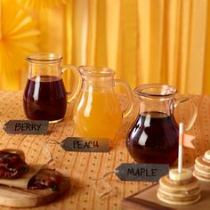 Using gift tags, label the varieties of syrup, and serve in portable, adorable serving glasses.