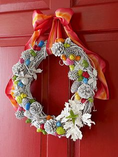 Paint 30-40 acorns and other nuts various colors; let dry. Meanwhile, hot-glue objects to the wreath; spray-paint white. When dry, hot-glue colorful nuts to wreath, as shown. Tie ribbon on wreath to hang.
