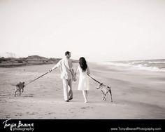 Dogs and engagement session! Couple walking on the beach!  Tonya Beaver Photography Jacksonville Florida Wedding Photography