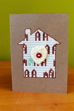 """Handmade and Original New Home // Housewarming // Moving House Card with a crochet heart and button. 7""""x5"""". """"Home is where the heart is."""" by DAISYandARTHUR on Etsy"""