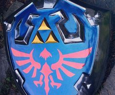 Put this year's Comic-Con outfit over the top by finishing it off with this Legend of Zelda Hylian shield. The shield is expertly crafted by hand from resin and filled with foam to keep it light - making it an ideal accessory for cosplay.