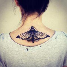 Beautiful black and white moth tattoo