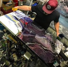 I don't like people in the studio while I'm working , I feel like I can't be as creative or paint the way I would if nobody is watching me..... But a couple pics were taken this week while in progress working on a larger piece for my upcoming show. Photo cred @tashibenns , studio is in a Francis Bacon state........ . . . . . . . . . . #resinart #resinartist #resin #art #ontarioartist #canadianart #londonontario #ldnont #modernart #contemporaryart #artist #abstractart #abstractpainting...