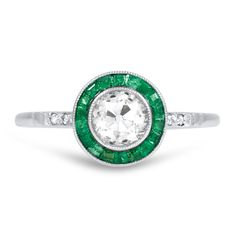The Enid Ring, absolutely love the style even the swirls in the setting. Would prefer with a teal or Montana sapphire.