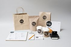 Coffee branding using a stamped logo. Like the idea of integrated cohesive design suite.