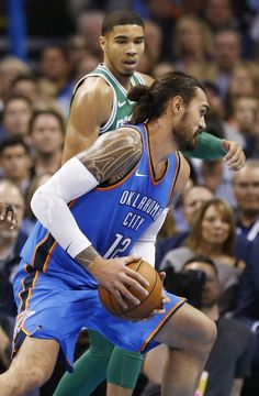 5c56ea47f Oklahoma City s Steven Adams (12) goes to the basket against Boston s  Jayson Tatum (0) in the first quarter during an NBA basketball game between  the ...