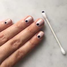 For the ultimate in simple, understated nail art, I love the look of a nude manicure with a single navy dot using the top of a @Qtips. #QtipsHack #sponsor