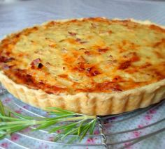 Basel Tart...with eggs gruyere onion bacon rosemary and cilantro