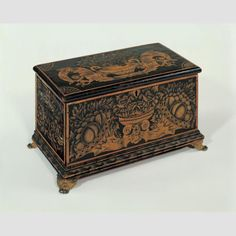 """""""R.A.CArtist unidentified; possibly Ransom Cook (1794–1881), probably Saratoga Springs, New York, c. 1830–1840, paint and bronze powder stenciling on wood with brass feet, 8 1/8 × 15 1/2 × 8 1/4"""", collection American Folk Art Museum, gift of the Historical Society of Early American Decoration: 88.19."""