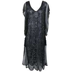 1920s Antique Black Sheer Sequins Embroidered Flapper Dress   From a collection of rare vintage evening dresses and gowns at https://www.1stdibs.com/fashion/clothing/evening-dresses/
