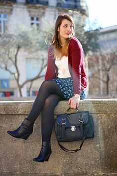 Black semi-opaque pantyhose with red cardigan, blue skirt with bird pattern and white blouse