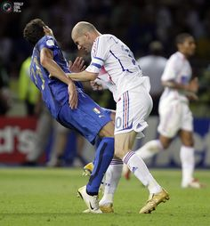 Italy's Marco Materazzi falls on the pitch after being head-butted by France's Zinedine Zidane (R) during their World Cup 2006 final soccer match in Berlin July 9, 2006.