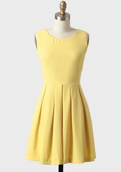 Pair this elegant dress with statement jewelry and your favorite heels or wedges for a polished look.