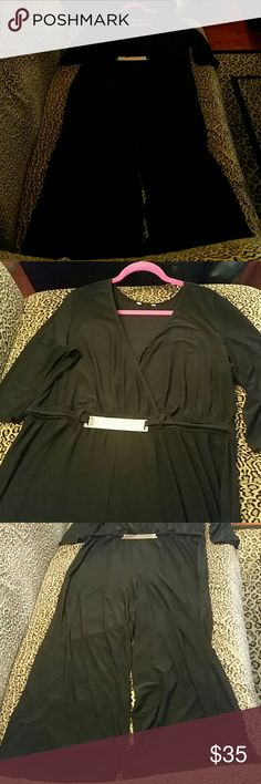 Elegant Jumpsuit Black Woman's 2X, very roomy and comfy one piece ensemble with gold tone hardware at waist. Stretch polyester. Worn once for our church gala. Great weight, hangs amazing!!! Itchy tag, had to be cut off....I am 5'4, perfect length with 4 inch open toe booties!!! Many compliments!!!! Other