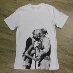 Deep Sea Diver. Everyone needs love, especially deep sea divers. Sometimes the only thing that can keep you warm in the briny depths of the sea is a kiss from a lovely bikini clad lady. http://truejersey.com