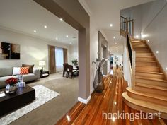 Open plan living room using grey colours with floorboards & staircase - Living Area photo 16517205