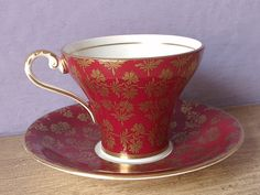 Teacup: Antique Aynsley red tea cup and saucer set