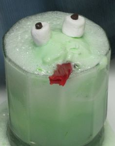 """Had this in pre-k and still remember it! """"Mr. Frog Float"""". Just Ginger-ale or Sprite with a scoop of lime sherbet. This is great for kids, but take away the marshmallow eyes and candy tounge, and add a bit of pineapple juice and lime slices and you have a delicious Lime Sherbet Punch."""