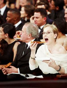 Meryl enjoying some pizza at the 86th Annual Academy Awards
