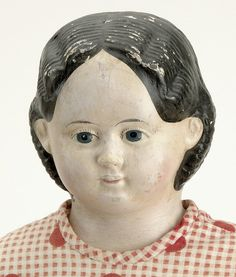 "American, ca. 1860, papier mache shoulder head, 1858 Greiner label, black center part hair with sausage curls, molded painted features with blue eyes, original cloth body, original red cotton print dress with gingham apron, red wool feather stitched petticoat, split drawers and leather shoes , 24"" t."