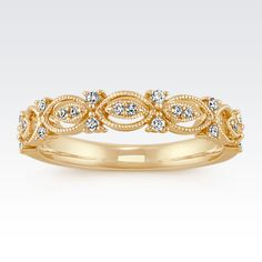 Twenty-two round diamonds, at approximately .15 carat total weight, are sprinkled about in this vintage-inspired wedding band. The 3.5mm design is crafted of quality 14 karat yellow gold and is completed by milgrain detailing. Wear this beautiful ring alone or add to complement an existing engagement ring.