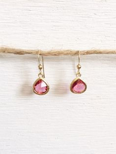 Small Hot Pink Glass Earrings These are a classic pair of mall hot pink tear drop earrings. These can be worn for just about any occasion can also be worn as bridesmaid earrings. These earrings can be matched or accessorized for a bridesmaid dress or to be given as a gift.    Spring/Summer colors to mix and match: White, coral, peach, aqua, pink
