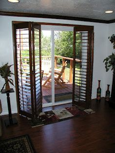 BiFold Shutters Open for ease of entry through your Sliding Glass Door.