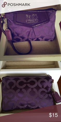 Coach wristlet Purple Coach signature wristlet, lightly used. The silver coach is fading but other than that it is in great condition. Coach Bags Clutches & Wristlets