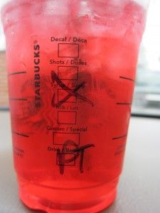 Starbucks Passion Ice Tea - hold the syrup.  Sugar-free, calorie-free, and with no artificial sweetener.  I just add half a stevia packet.