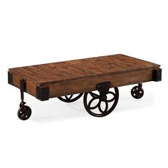 Larkin Natural Pine Cocktail Table with Casters
