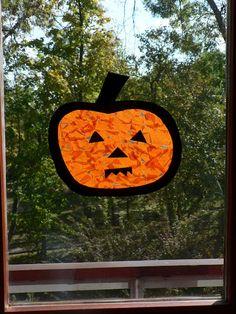 preschool craft: {Pumpkin Suncatcher Jack-O-Lantern Play}