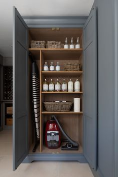 Every utility room needs a utility cupboard to put away all the essentials like a Miele vacuum cleaner (which is absolutely phenomenal especially if you've got pets!). Bespoke shelving in the cupboards ensures everything from an ironing board to baskets of linens fits in. #humphreymunsonblog
