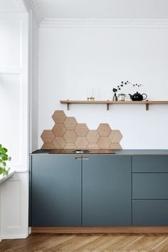 Kitchen Interior Blue Kitchen Cabinets Hexagon Backsplash in Appartment in Copenhagen Blue Kitchen Cabinets, Kitchen Tiles, New Kitchen, Kitchen Decor, Grey Cabinets, Kitchen Corner, Kitchen Wood, Awesome Kitchen, Kitchen Modern