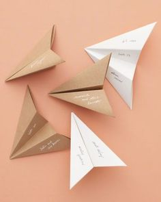Paper airplane seating cards make a 'fold here' wedding invitation Wedding Seating, Wedding Table, Wedding Favors, Wedding Invitations, Wedding Day, Wedding Flowers, Wedding Ceremony, Destination Wedding, Wedding Places