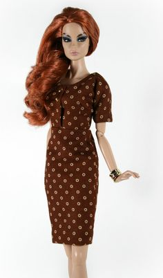 Fully lined short sleeved dress made in a brown cotton print fabric with goldtone accents. Dress has snap closures.  Designed to fit Barbie,