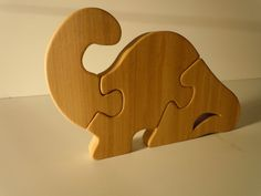 Brontosaurus dinosaur puzzle.  Great natural toy, hand made for years of imaginative play.