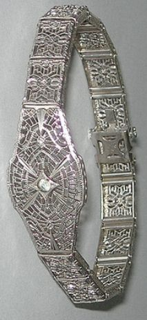 Sterling silver Art Deco filigree bracelet by JH Peckham. Via Diamonds in the Library.