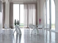 Eliseo - Big Eliseo Tonin Casa Round table with base in painted metal and top in tempered glass electro-welded with UV rays on steel plates for maximum quality and aesthetic design. Elegant and contemporary in the three-coloured version. Big Eliseo is perfect for those wishing their dining room to be unique with formal and exclusive lines. - See more at: http://www.martinelstore.com/en/prod/tables/eliseo-tonin-casa.html