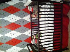 Red and gray argyle nursery