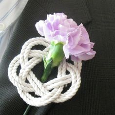 Nautical Woven Boutonniere for your groom, best man and usher for your seaside wedding. This is a boutonniere made to look like and antique thump pad. This knot has a deep history in sailing as it pro