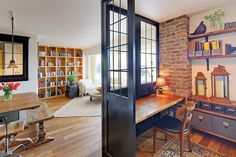 Eclectic Home Office with Hardwood floors, Built-in bookshelf, interior brick, Exposed brick, Reclaimed wood desk