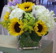 Flower delivery in North Arlington by North Arlington florist - sunflowers solidago carnation and hydrangea with stones on the bottom of vas. Sunflower Centerpieces, Sunflower Arrangements, Unique Flower Arrangements, Wedding Centerpieces, Table Flowers, Sun Flowers, Bridal Flowers, Flower Delivery, Fall Wedding
