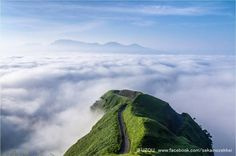 , Japan The farm road in western part. When a sea of clouds occurs, it is visible as if it have floated in the sky. It is connected with the Ghibli movie and loved by this name. Places Around The World, Around The Worlds, Sky People, Japan Landscape, Kumamoto, Japan Photo, Natural Scenery, What A Wonderful World, Beautiful Places To Visit