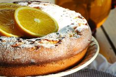 Torta de la abuelita  Ingredientes  100 grs de manteca  1 taza de azúcar  2 huevos  ralladura limón o naranja  1 taza de leche  2 tazas de harina  2 cditas de polvo para hornear  azúcar impalpable, c/n