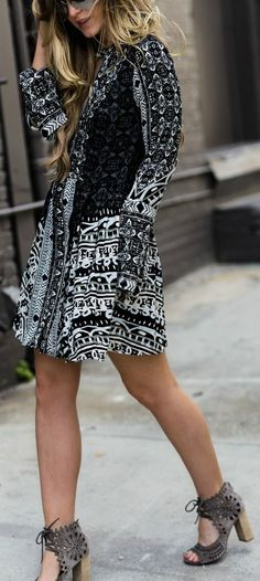 Edgy spring outfit with pattern dress, lace up block heel sandals, and mirrored sunglasses