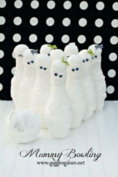 For more mummy-themed fun, wrap up some plastic pins in toilet paper and glue on some googly eyes for this bowling game. Click through for more DIY Halloween game ideas for this year's Halloween party.