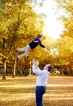 non-verbal boy with Autism being made happy by being tossed in the air by father.  Special needs photographer
